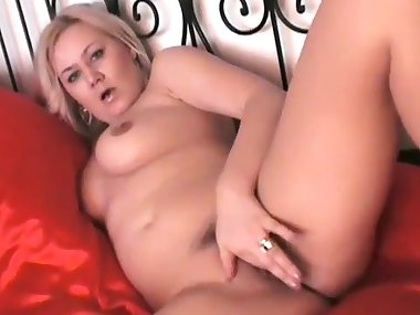 Busty blonde mom in the bedroom