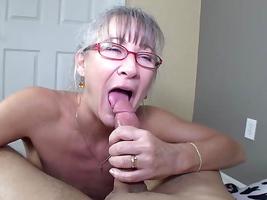 Pretty hot granny is sucking a nice cock