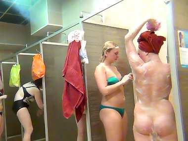 Busty babes are getting naked in the shower