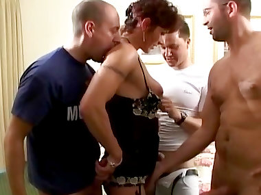 Curly-haired mature fuck with gang of hard dicks