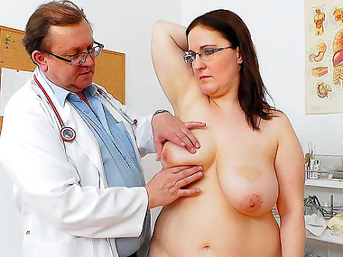 Doctor checks chubby brunette's big tits and..