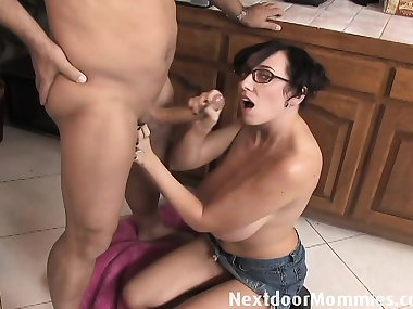 Big breasted mom strokes a black cockBig breasted mom gives