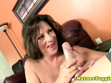 Busty cougar mom jerking his dong