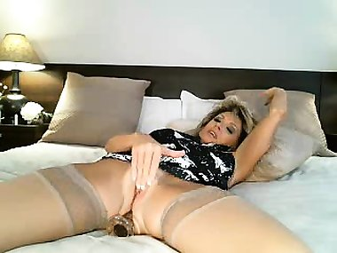 Naughty blonde mom in stockings pleases her fiery pussy on