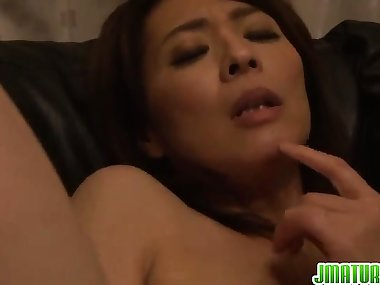 Horny mom plays with her fingers