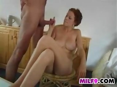 MILF Smokes And Strokes On A Hard Cock